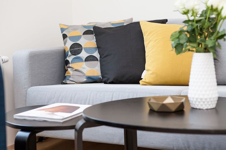 Original Image of a Sofa, Coffee Table, and Pillows Before Jimp Image Manipulation