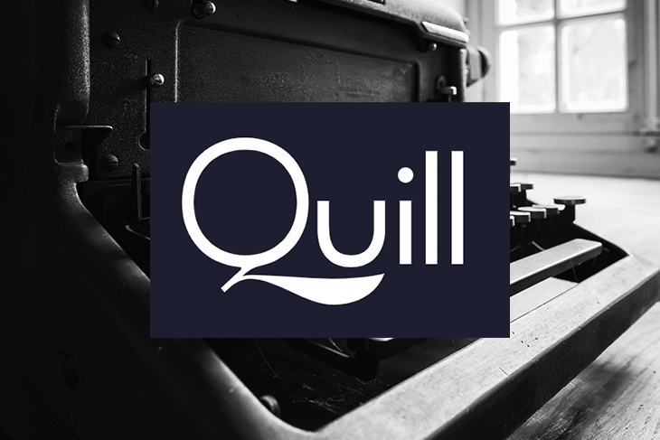 Quill Logo Over a Typewriter